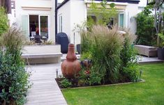 Garden ideas for small spaces garden design for small for Garden decking north london