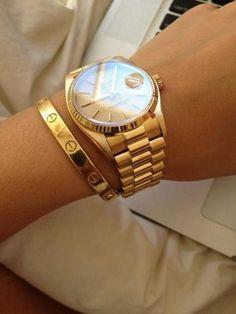 the wrist essentials.. Gold Rolex watch and Cartier Love bracelet <3