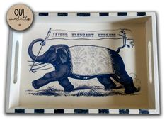 "PRODUCT DESCRIPTION    Indigo elephant serving tray handcrafted and hand painted. Perfect to gift someone special or a lovely accesory in your kitchen.    It is distressed to have vintage look .  The wood characteristics and distressing will vary. We use MDF wood that has character with knots, holes and rough edges and this will vary from the photos as well.         GENERAL DETAILS    Fabric/ Material	Mdf  Microwave Safe	No  Colour- Indigo & Beige   Dimensions- 12"" X 8 "" 