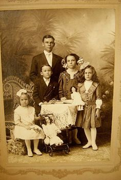Well dressed Edwardian family including two little girls with their dolls;1900's.