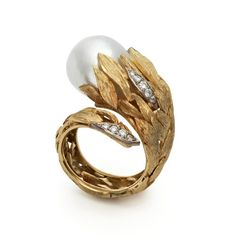 Andrew Grima  Pearl Ring, 2011  A cultured Pearl set in Yellow Gold leaves with pave-set Diamonds