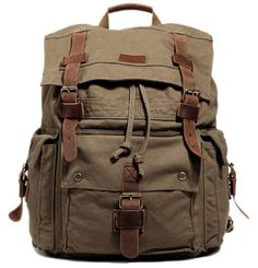 "Main Material: All canvas rucksack with leather straps.    Size: H:18"" L:13"" W:6""   Interior: With a..."