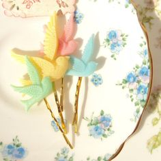 Sparrow bobby pin set $15.00 ~ http://www.etsy.com/listing/85492275/soaring-beyond-the-rainbow-sparrow-bobby