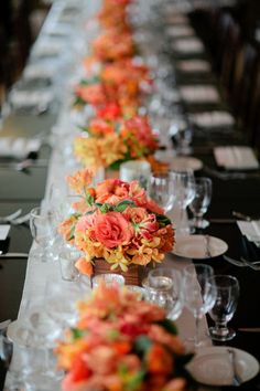 Sunset colored centerpieces in rustic boxes