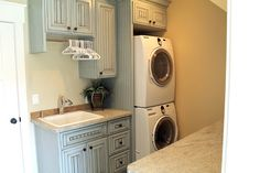 """Laundry room + family closet--YES!!  I """"came up"""" with this idea not too long ago, realizing that some other lucky people had most likely already thought of it, and here is a great example!  Dream house idea..."""