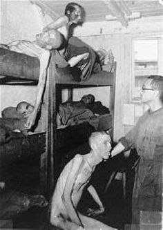Liberated inmates inside the Mauthausen barracks. How much longer they survived is unknown. And some believe the Holocaust never existed.