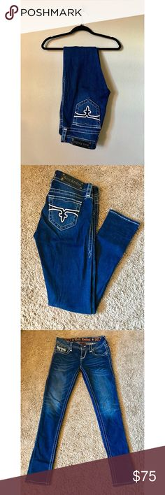 """ROCK REVIVAL - Dark Skinny Jeans - 28 Rock Revival """"Pearl"""" dark wash skinny jeans with white stitching and matte black hardware. Simple pockets. Some whiskering. Worn maybe 1-2 times. Smoke free home. Rock Revival Jeans Skinny"""