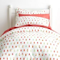 Kids sheets and bedding set covered in colorful frozen treats. Woven of 200-thread count cotton percale. Perfect for layering.
