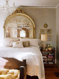 love the idea of an antique mirror as a headboard, this one has a louis xvi feel, especially with the chandelier!