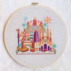 This modern cross stitch pattern of Barcelona features the famous Sagrada Familia cathedral, the Arc de Triomf, Torre Agbar, Catedral de Santa