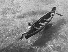 A fashion model sits on the edge of a boat in Montego Bay, Jamaica, in November of # Toni Frissell / Library of Congress Patrick Nagel, Robert Doisneau, Edward Hopper, Alphonse Mucha, Fashion Model Poses, Fashion Models, Alfred Stieglitz, Galerie D'art, Ordinary Lives