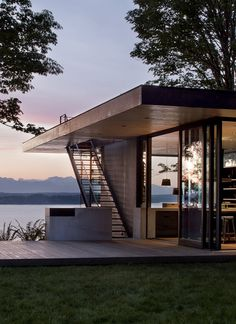 Interesting to see how the staircase pierces the roof overhang to access the flat roof (seating area, I suppose). Nice view! Modern getaway by mw|works