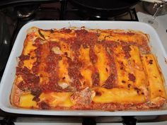 Cannelloni filled with egg and ricotta mix and covered with a bolognese sauce......added milk to cover all the cannelloni. Put covered with foil in oven for about 30 mins (or according to instructions) and then uncovered for another 10 mins