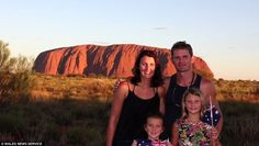The parents home schooled their daughters as they visited 12 countries, pictured at Ayers Rock, also known as Uluru, in central Australia