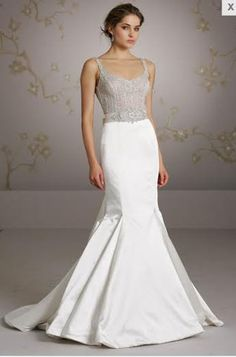 Hi Ladies! I am selling a brand new, unaltered, unworn Lazaro LZ3052 in a designer size 10 (fits a street size 4-6 or smaller with alterations). The gown is a silk satin trumpet in ivory, with a plati