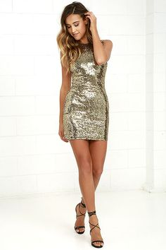 Make your look more than magnificent by slipping on the Shining Splendor Gold Sequin Bodycon Dress! Stretch knit is embellished with shimmering gold sequins as it shapes a figure-flaunting fit, with a rounded neckline, and racerback. Bodycon skirt has a leg-baring length. Hidden back zipper.