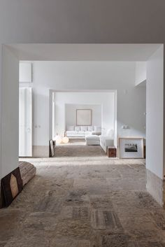 What amazing stones on the floor! Renovated 18th-century building on a hillside in Lisbon with stone paved floors