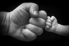 Daddy/baby fist-bump.
