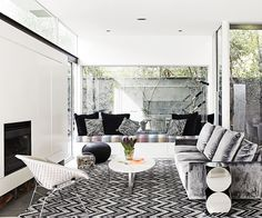 """The custom made Sky sofa by [Jardan](http://www.jardan.com.au/ target=""""_blank"""") was upholstered in Veluto velvet Metal from [Mokum](http://jamesdunloptextiles.com/ target=""""_blank""""). """"It's so soft, textural and dreamy – I could lay there all day,"""" says Sally.   Lighting **rug** from [Rugs Carpet & Design](http://www.rc-d.com.au/ target=""""_blank""""). Athenium **coffee table** from [Surround Interiors](http://surround.com.au/ target=""""_blank"""")."""