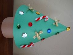 Children will love to make their very own Cone Christmas Tree! Dress your tree with scraps from around the house like buttons, felt, sequins and such! Preschoolers will need help making the cone, but they'll love to decorate their very own tree.