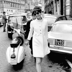 Love this coat.  Photographed in the time Audrey Hepburn lived in Rome, in the 1960s-70s.