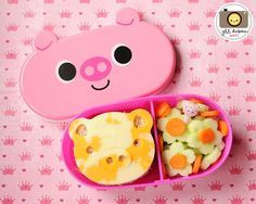 LUNCH BOX IDEAS-used the Cutezcute cutter set to make the piggy sandwich. On the other side of the divider were flower cut cucumbers, sliced baby carrots and a piggy pick.