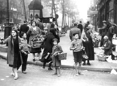 January 1930, children are seen selling lilies in the streets of Paris.