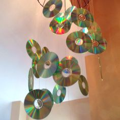 Rock Band Party: CD mobile. My sister made this out of blank CD's, fishing line, and a plant hanger.
