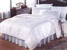 """Queen Oversized and Overstuffed Concorde White Goose Down Comforter (90"""" X 96"""") by Phoenix Down ®. $349.99. Fabric: 410 Thread Count, 100% Cotton Cover. White Geometric Pattern. Queen Size Comforter: 90"""" x 96"""". Fill: 700 Fill Power White Goose Down. Construction: 15"""" Baffles to Ensure Consistent Warmth. The Phoenix Down® Concorde White Goose Down Comforter is filled with premium imported white goose down.  With an amazing 700 fill power, the Phoenix Down® Concorde White Goose ..."""