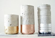 Metallic concrete votives:  use old bottles to create concrete objects and combine metallic spray paint.
