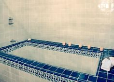 Love blue talavera tile in a bathroom.