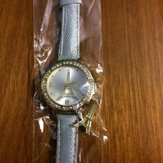 Paris Watch Still in the package. The other part is a blue color. Just decided I wanted something different!  Cheaper on Mercari Accessories Watches
