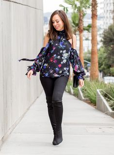 Sydne Style shows how to wear a dark floral top and over the knee boots with jeans #florals #falltrends #boots