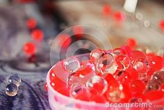 Red  and transparent drops of water on a table
