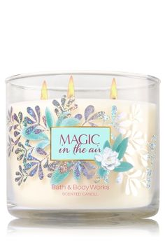 """Magic in the Air - 3-Wick Candle - Bath & Body Works - The Perfect 3-Wick Candle! Made using the highest concentration of fragrance oils, an exclusive blend of vegetable wax and wicks that won't burn out, our candles melt consistently & evenly, radiating enough fragrance to fill an entire room. Plus, a gorgeous lid with glitter & pearls adds extra magic to your d�cor! Burns approximately 25 - 45 hours and measures 4"""" wide x 3 1/2"""" tall."""