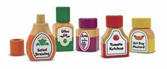 Magnetic Kitchen Bottle Collection : Add flavor to early pretend play with this 10-piece wooden condiment set.  Decorative art for ketchup, mustard, salad dressing, olive oil and grape jam appears on the labels of these easy-grasp bottles.  Featuring color-coded magnetic lids that snap on and off, this set is perfect for pretend play!  Brightly painted with non-toxic paint.