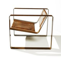 SQUARE CHAIR. Buffalo hide and patinated steel.