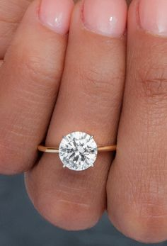 Minimal Yellow Gold Engagement Ring 2 carat Round Brilliant Cut Diamond Solitaire Engagement Ring with simple, thin band in yellow gold. Gold Band Engagement Rings, Round Solitaire Engagement Ring, Gold Wedding Rings, Wedding Jewelry, Wedding Band, Gold Rings, 2 Carat, Fine Jewelry, Jewellery
