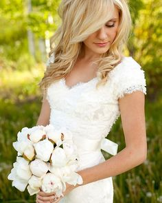 A modest wedding dress that doesn't have a square neck and cap sleeves! It's super cute :)