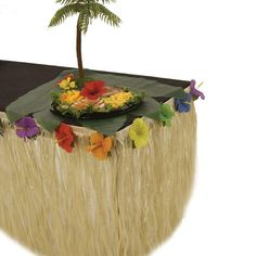 """Table Skirt - Natural Nylon with Hibiscus Flowers - able Skirt - Natural Nylon with Hibiscus Flowers Includes (1) natural color nylon table skirt with hibiscus flower accents in assorted colors. Measures approximately 29"""""""" high x 108"""""""" wide. Please Note: Table and food are not included. Palm Tree and Ti Leafs sold separately.  $23.95 each."""