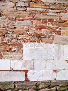 tuscany wall with layers of white marble - Interesting color variance with red Italian bricks and white marble blocks