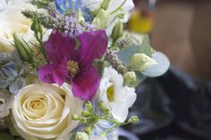 Bridal shower bouquet of Avalanche Roses, pale blue Delphiniums, pink Clematis, Vuvuzela Roses, and seasonal herbs, designed and created by Hannah Berry Flowers www.hannahberryflowers.co.uk