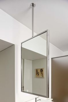 M Is A Suspended Mirror That Uses The Ceiling As Its Only Fixing Point