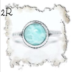 Sterling silver and larimar ring. Sample ring is a size 7 but can be made to order. Sterling silver with large, beautiful larimar cabochon. Very simple and looks great stacked with multiple silver bands. IEdesigned Jewelry Rings