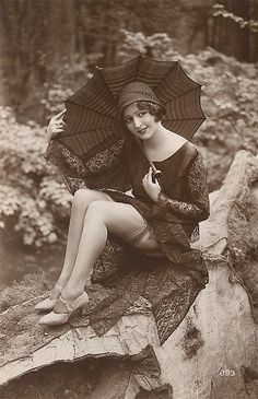1920's lady showing of her stockings. So risqué!     Vintage Parasol