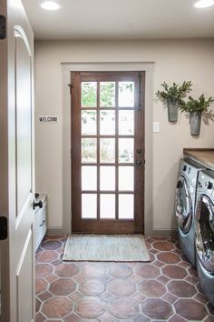 The Saltillo tile flooring brings the Italian theme into the mudroom and the powder bath. This is a perfect option for the mudroom because it's durable and won't be bothered by a few splashes of water or mud.