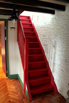 Red stairs always lead SOMEWHERE! I love this painted red staircase in an old Irish Cottage.