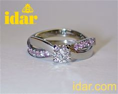 """Idar's copyright """"infinity twist"""" ring, with pink sapphires and diamonds, handmade in 19K white gold."""