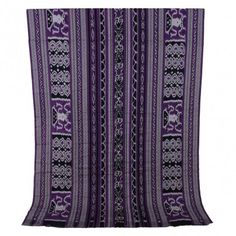Manado Ikat Woven Cloth. This woven cloth has been processed from strands of threads tied together and dipped into natural coloring, then weaved into a signature and beautiful purple Manado cloth. You can create any outift using this cloth. $85.00