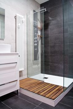 Wooden slats for walking onto after you get out of the shower.
